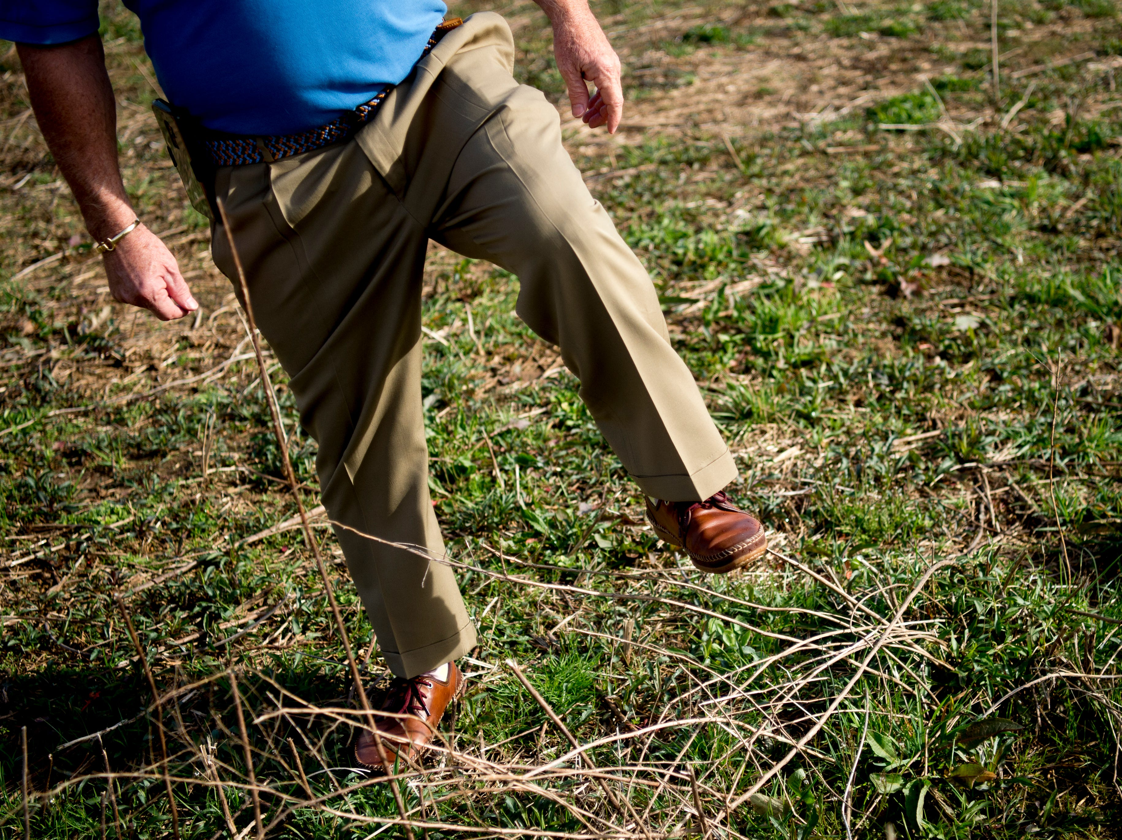 Joe Hollingsworth, president of the Hollingsworth Foundation, steps over some overgrowth at the site of the future Aspire Park in Clinton, Tennessee on Tuesday, March 12, 2019. The Hollingsworth Foundation is looking to redevelop nearly 450 acres of land off Yarnell Road into a recreational park.