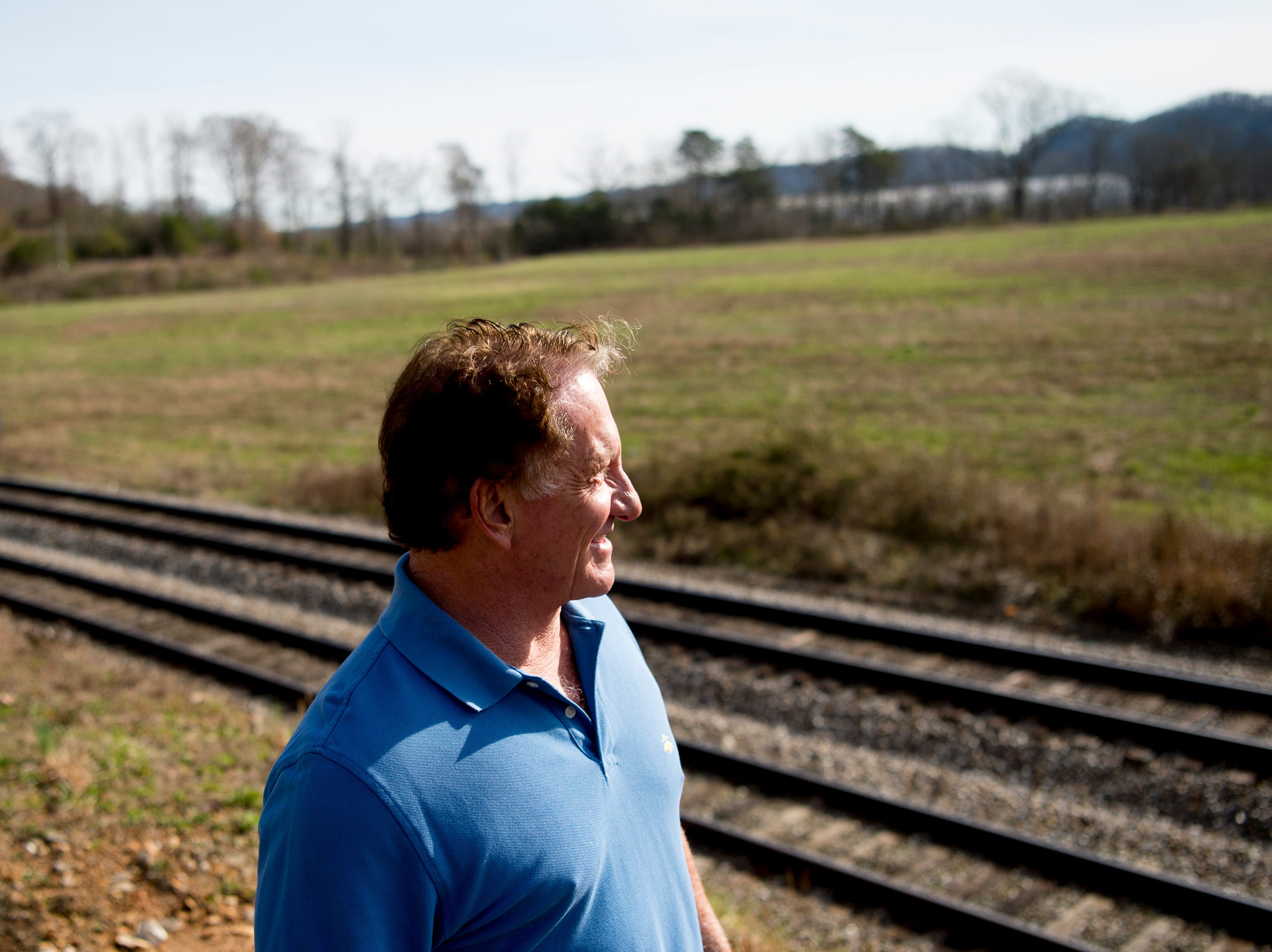 Joe Hollingsworth, president of the Hollingsworth Foundation, looks over the site of the future Aspire Park in Clinton, Tennessee on Tuesday, March 12, 2019. The Hollingsworth Foundation is looking to redevelop nearly 450 acres of land off Yarnell Road into a recreational park.