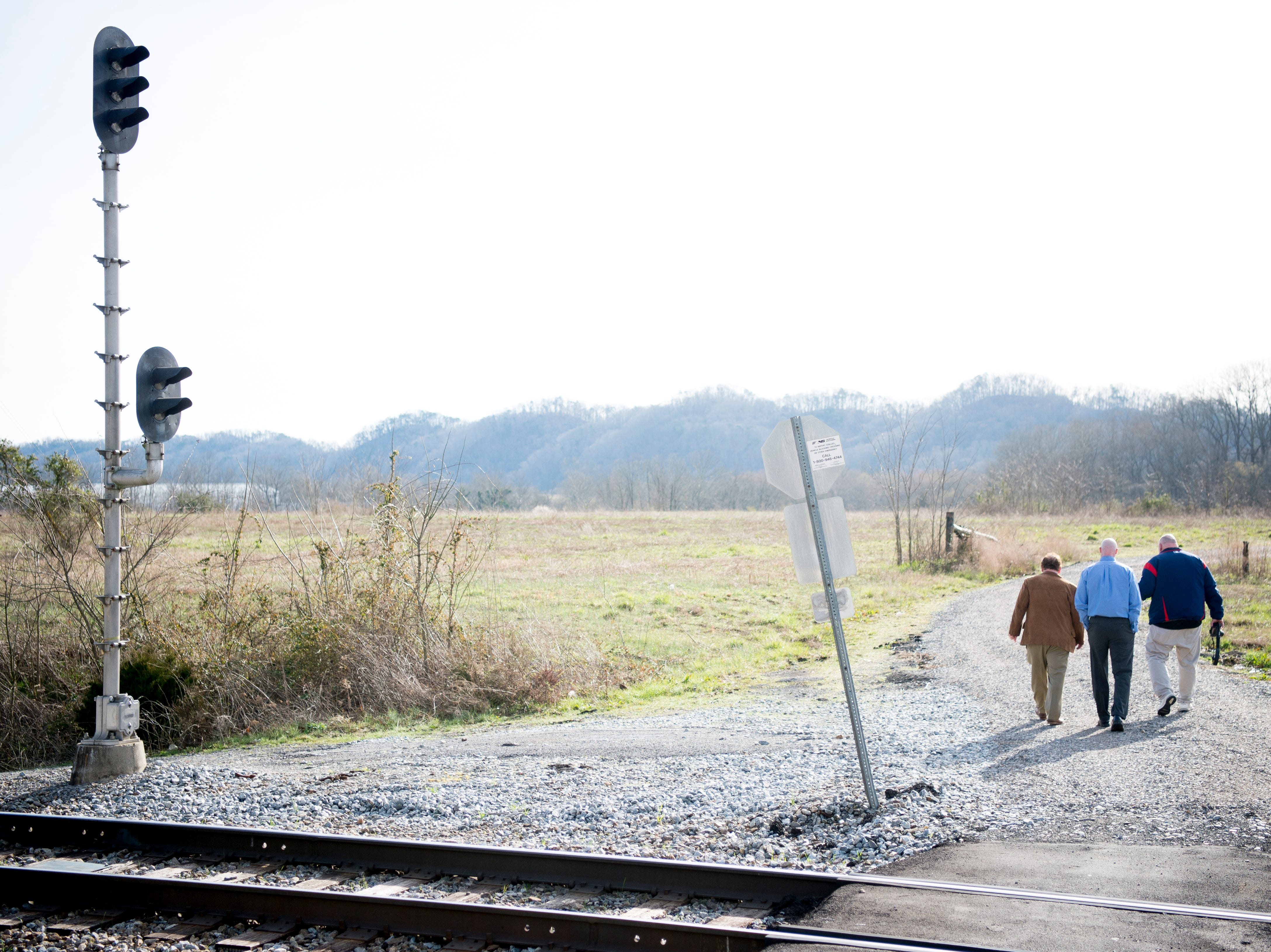 From left, Joe Hollingsworth, Mike Wallace and a reporter walk at the site of the future Aspire Park in Clinton, Tennessee on Tuesday, March 12, 2019. The Hollingsworth Foundation is looking to redevelop nearly 450 acres of land off Yarnell Road into a recreational park.