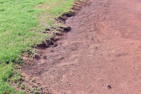 A close-up of the infield near third base of the Powell High softball field.
