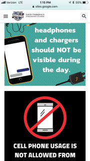 Graphics on David Thibodaux STEM Magnet Academy's home page remind students that headphones, chargers and cell phones should not be visible during the school day.