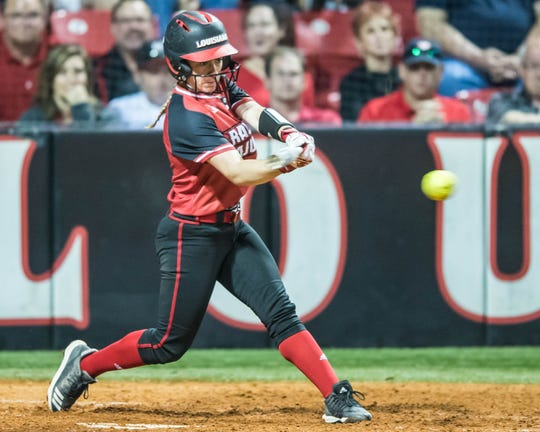 UL third baseman Kara Gremillion makes contact with the ball as the UL Ragin Lady Cajuns play the Baylor Bear on Monday  night at Lamson Park.