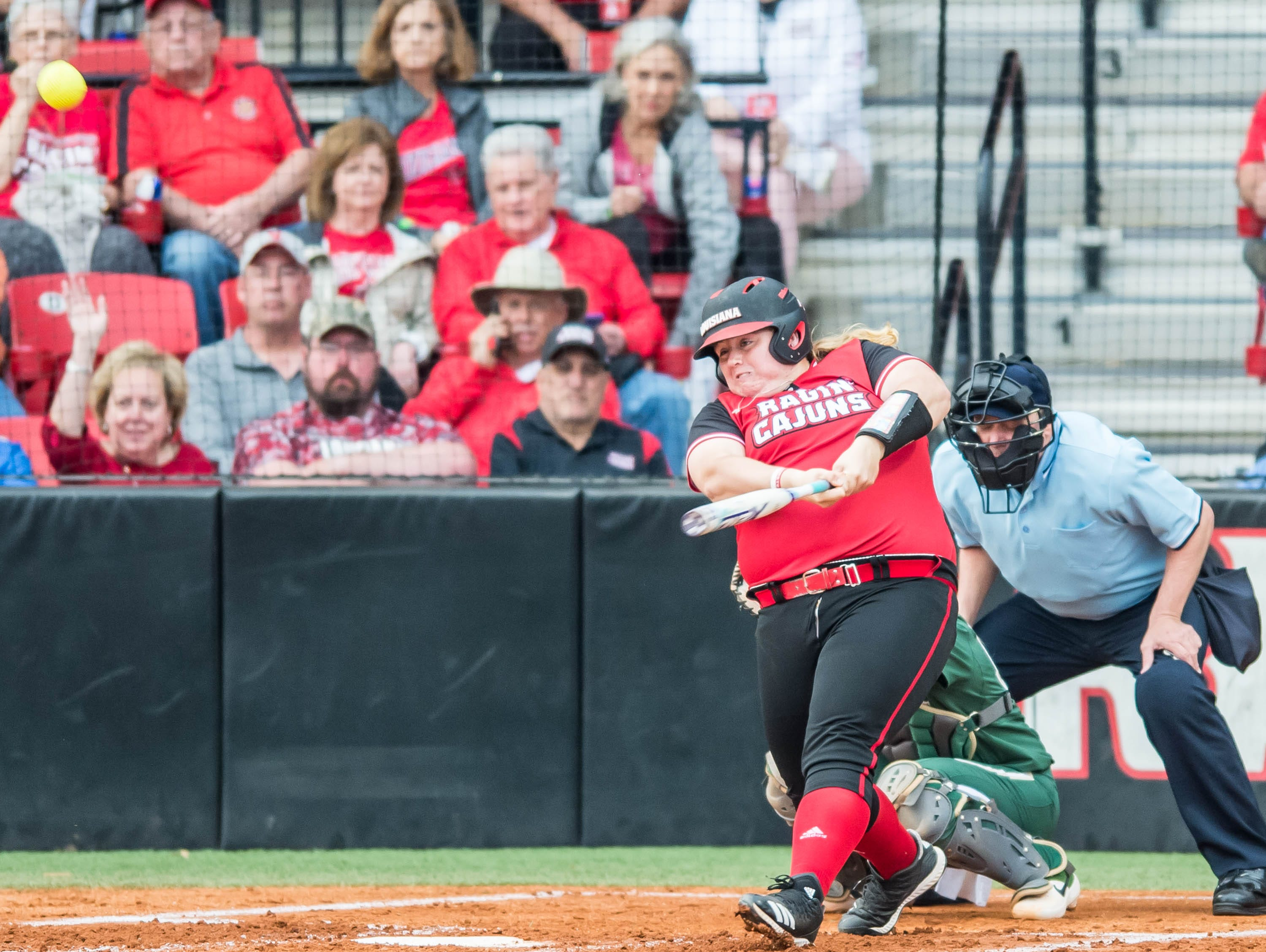 UL first baseman Bailey Curry makes contact with the ball on Monday night at Lamson Park.