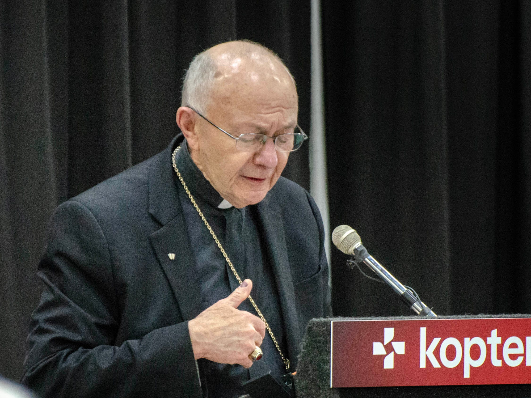 Bishop J. Douglas Deshotel opens the conference with a prayer at the Kopter Manufacturing Faciltiy Dedication.