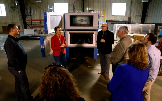 Ellen Conway Merrill, left, and Richard Conway talk to a group of village and county representatives Tuesday, March 12, 2019, as they give a tour of Delta H Technologies LLC in Carroll. Richard Conway started the company in the 1990s and began manufacturing heat treatment ovens that are mainly used in the aerospace industry a little more than 10 years ago. Delta H's products are sold worldwide and are used by private companies and militaries. The company announced a new expansion that will double its workforce.