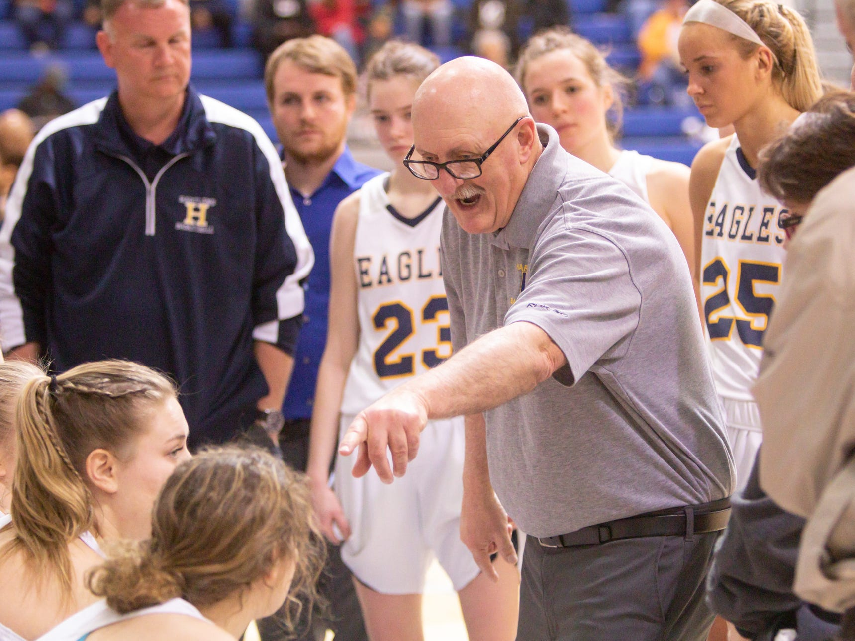 Hartland varsity coach Don Palmer gives instruction during a time-out in the fourth period of the semifinal game against West Bloomfield Monday, March 11, 2019.