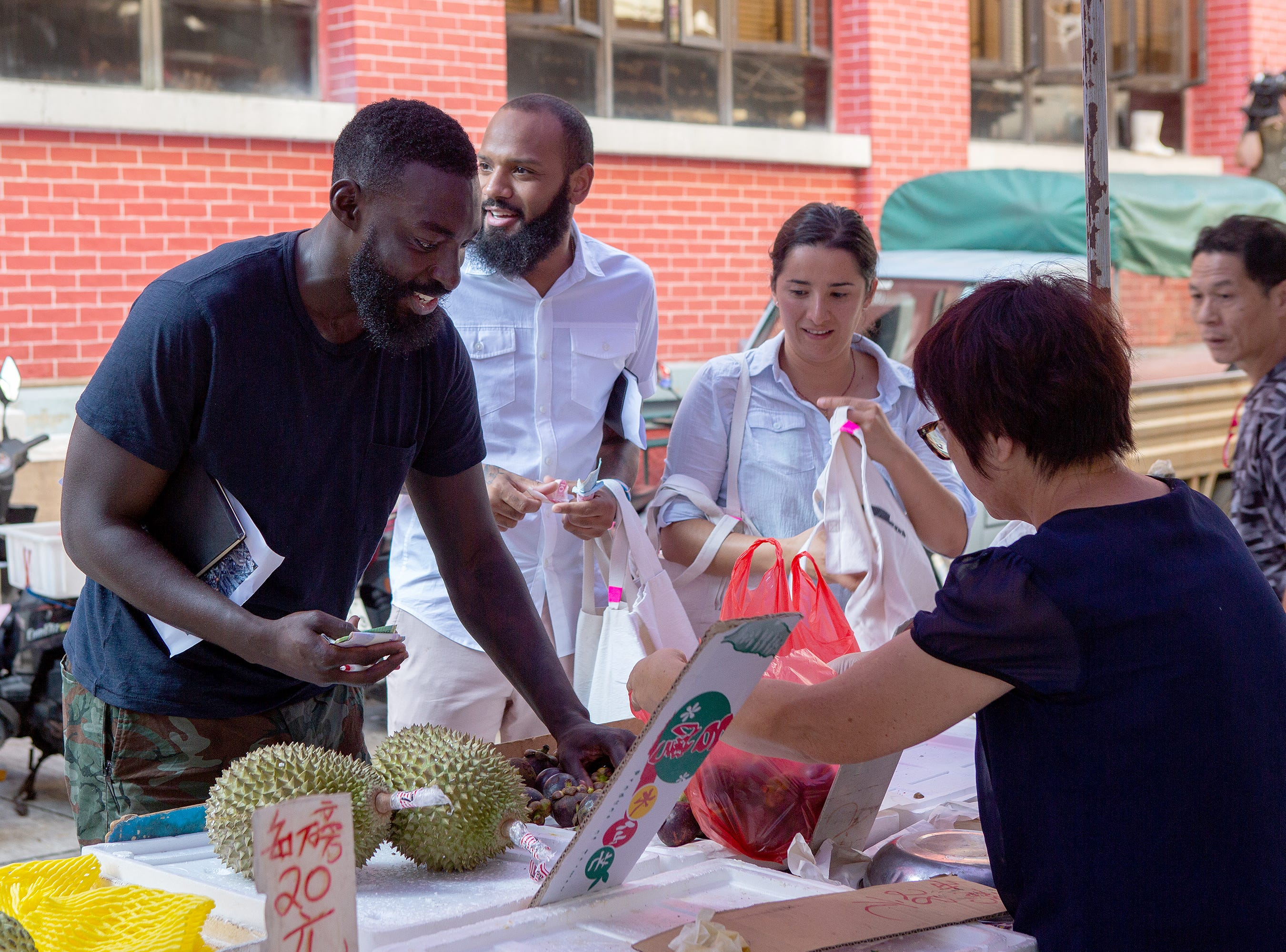 (Left to right) Finalist Eric Adjepong, with former contestants Justin Sutherland and Michelle Minori, shops for ingredients on episode 15 of 'Top Chef' Kentucky.