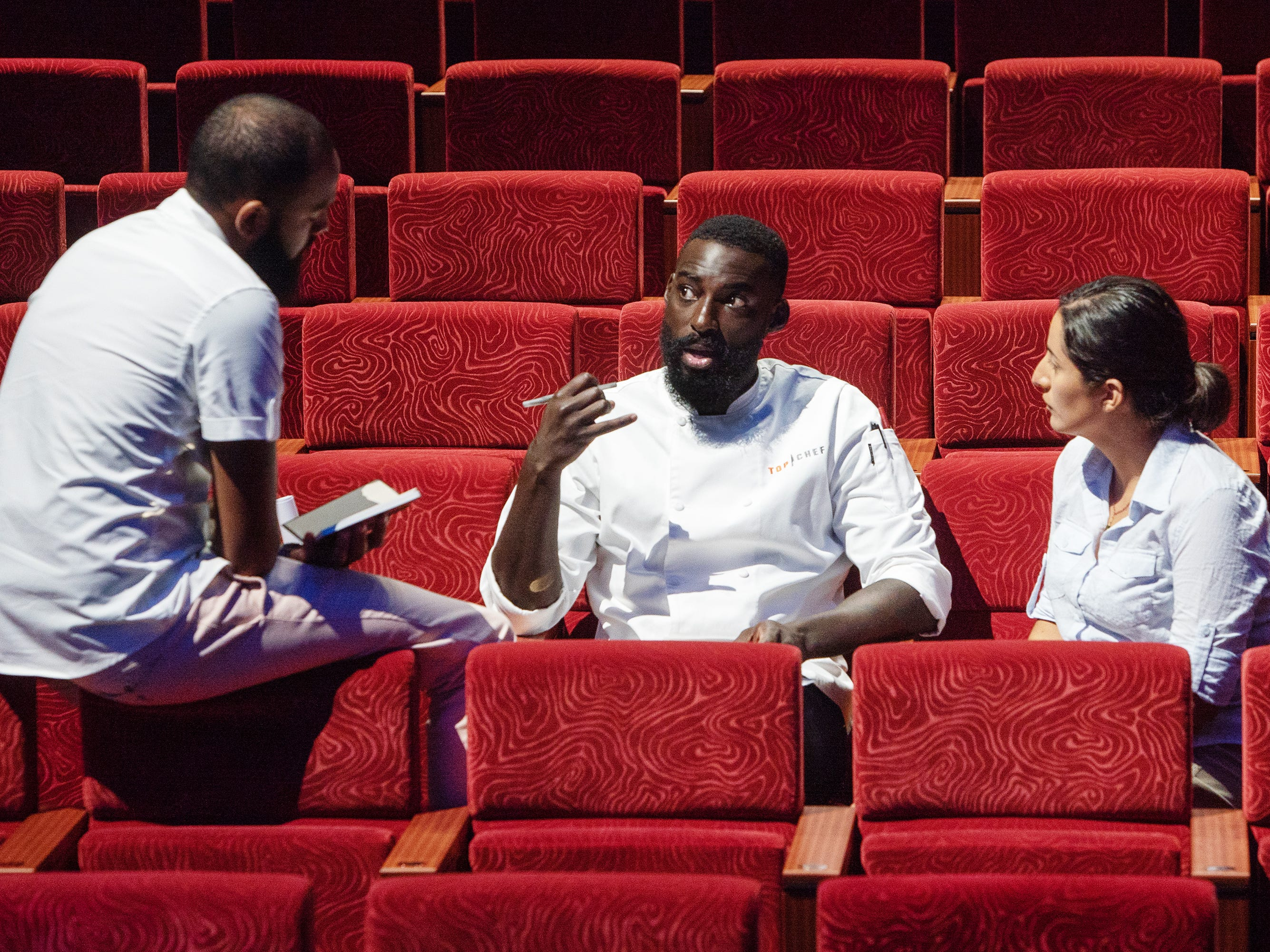 Finalist Eric Adjepong (center) plans his menu with former contestants Justin Sutherland and Michelle Minori on episode 15 of 'Top Chef' Kentucky.