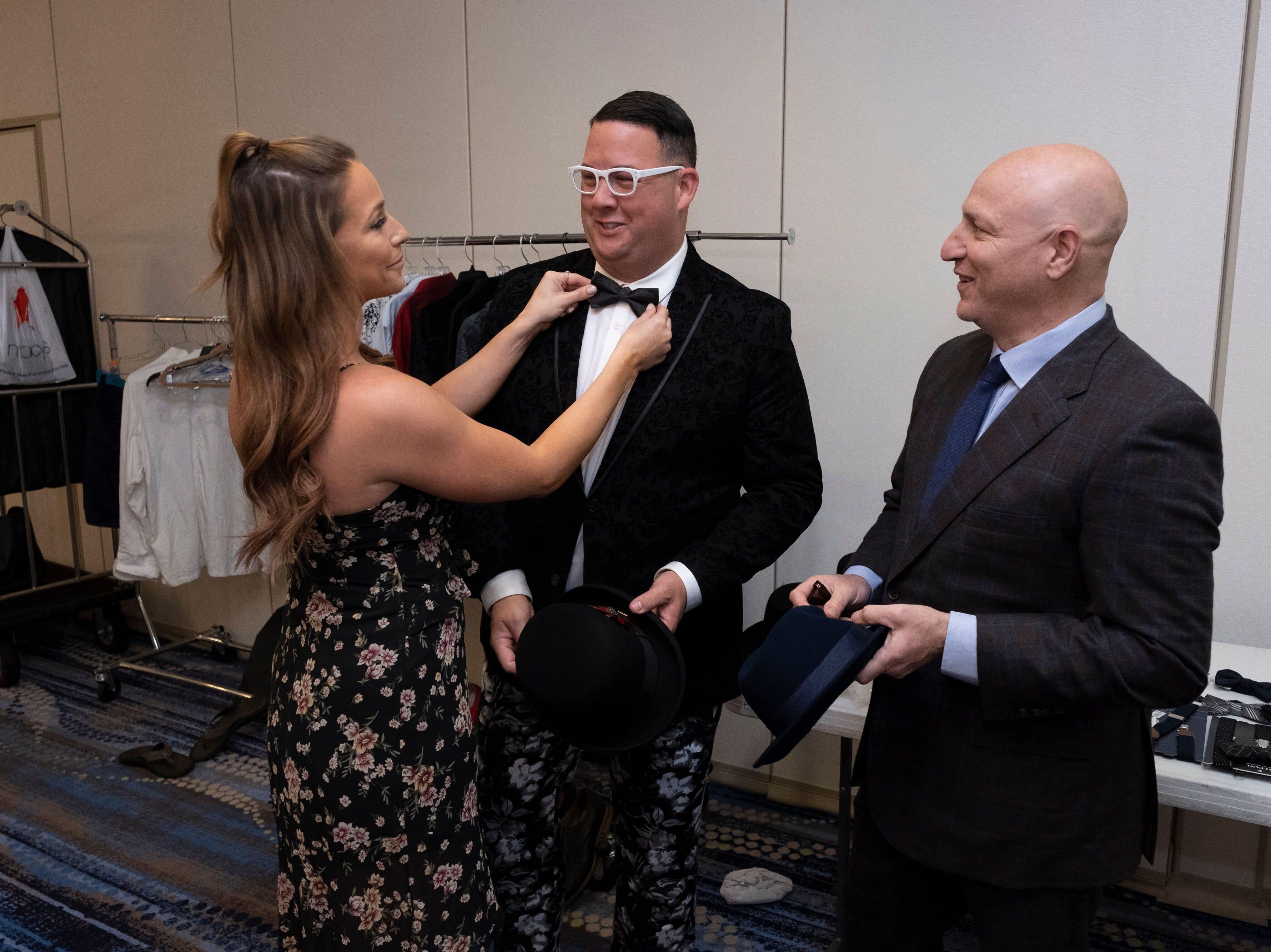 "Celebrity stylist  Charlotte Rose Coleman adjust ""Top Chef"" judge Graham Elliot's bowtie.  ""Top Chef"" judge Tom Colicchio stands by."