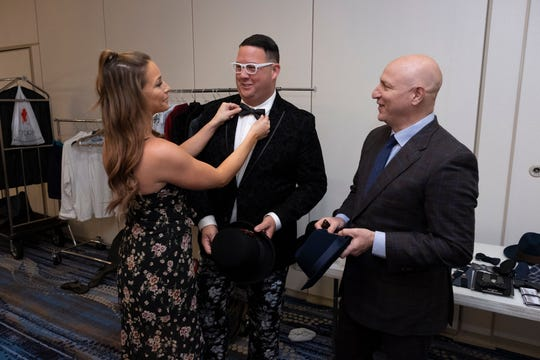 """Celebrity stylist Charlotte Rose Coleman adjusts """"Top Chef"""" judge Graham Elliot's bowtie. """"Top Chef"""" judge Tom Colicchio waits his turn for final adjustments."""