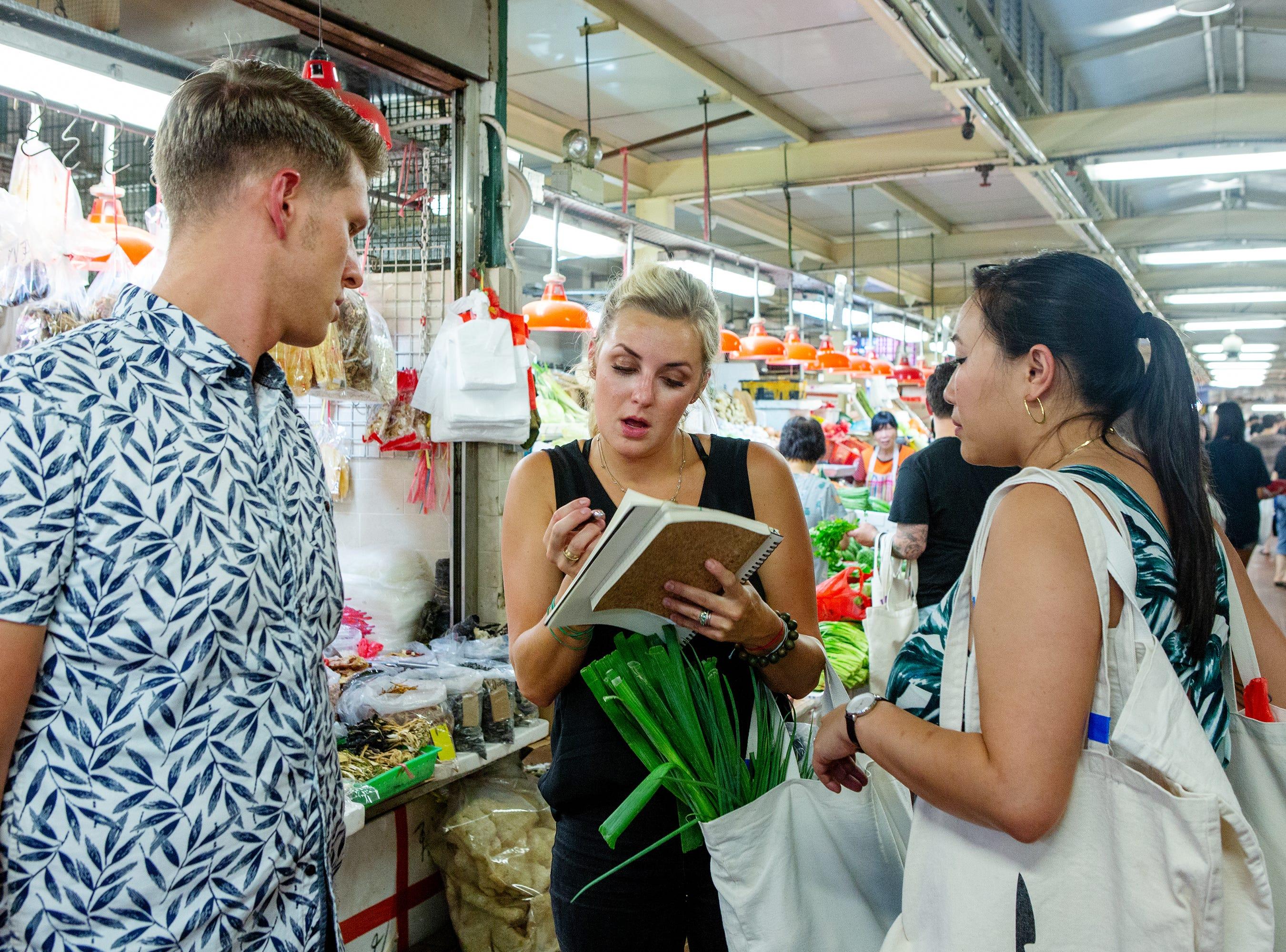 Finalist Kelsey Barnard Clark (center) shops for ingredients with former contestants Brandon Rosen and Nini Nguyen on episode 15 of 'Top Chef' Kentucky.