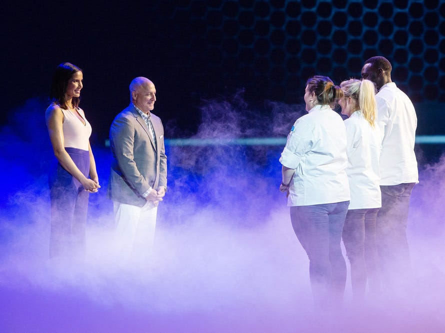 Host Padma Lakshmi and head judge Tom Colicchio address the final three chefs in 'Top Chef' episode 15, season 16.