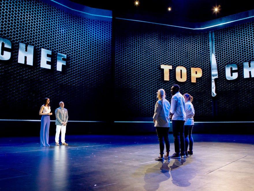 'Top Chef' host Padma Lakshmi and head judge Tom Colicchio address finalists Kelsey Barnard Clark, Eric Adjepong and Sara Bradley on episode 15 of season 16.