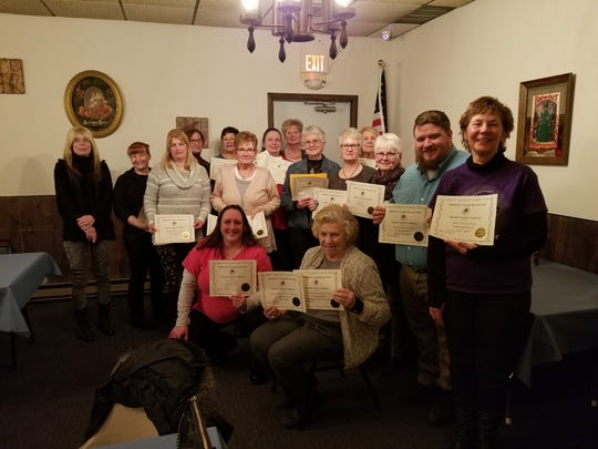 Manitowoc County Kennel Club recently honored members who have earned a title with their dog in the past year. Pictured from left, front row: Jen Hynek and Sharon Bruckschen; middle row: Michelle Hansen, Jennifer Tollefson, Karen Smith, Kay Detampel, Nancy Sawdo, Bob Maloney and Mary Pohl; and back row: Kay Christel, Sara Hallam, Laurie Sales, Laurale Stern, Jeanine Montag, Donna Hlavachek and Mary Larson.