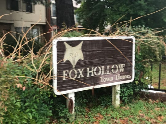 The sign outside the beleaguered Fox Hollow Town Homes