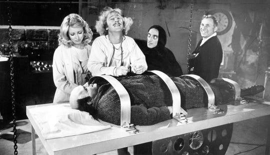 "On the set of ""Young Frankenstein"": Teri Garr (left), Gene Wilder, Marty Feldman, director Mel Brooks and Peter Boyle as Young Frankenstein."