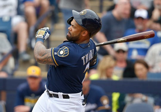 Eric Thames watches his double as a Brewer.