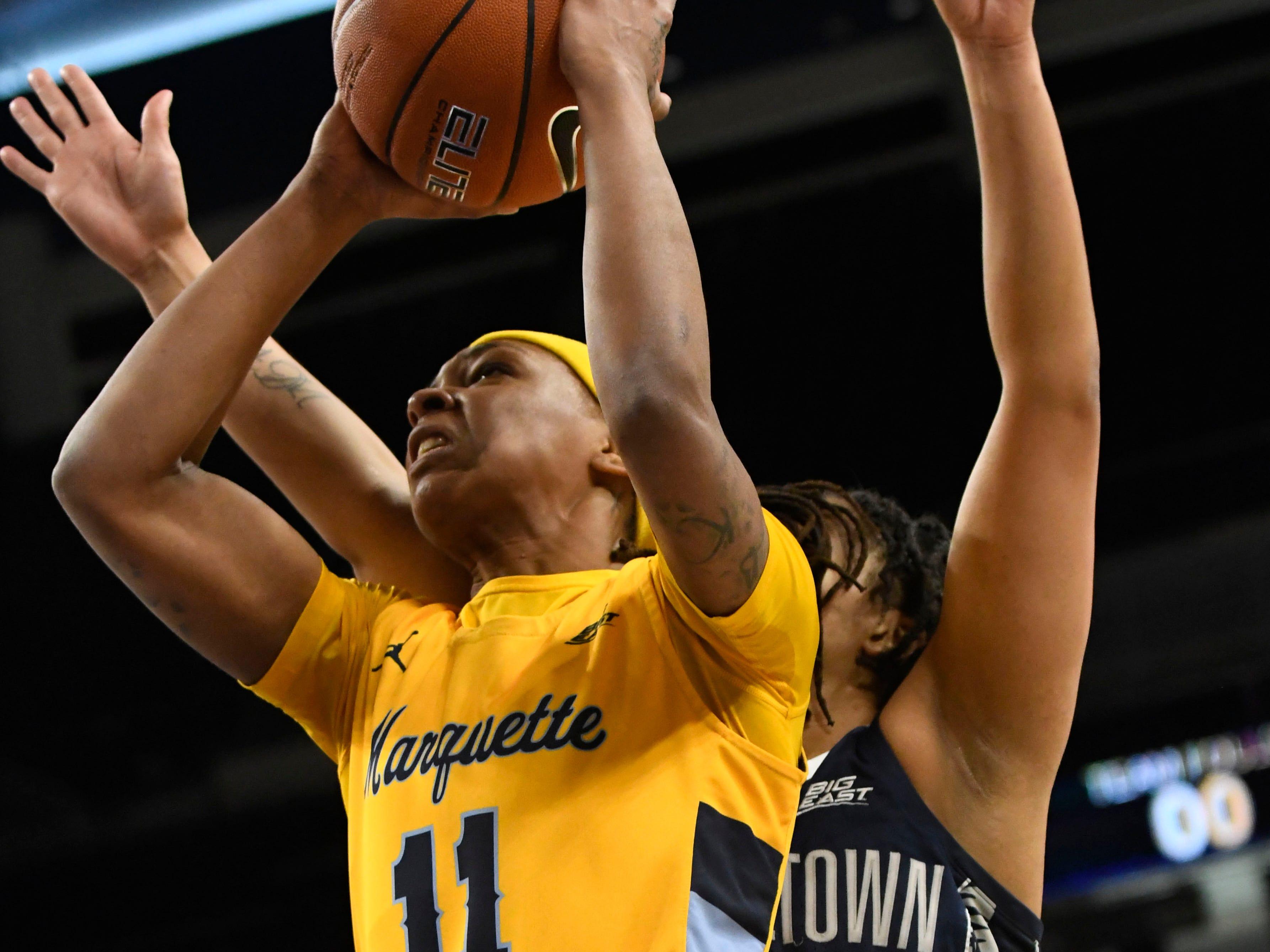 Marquette  Allazia Blockton goes to the basket as Georgetown Hoyas guard Mikayla Venson defends.