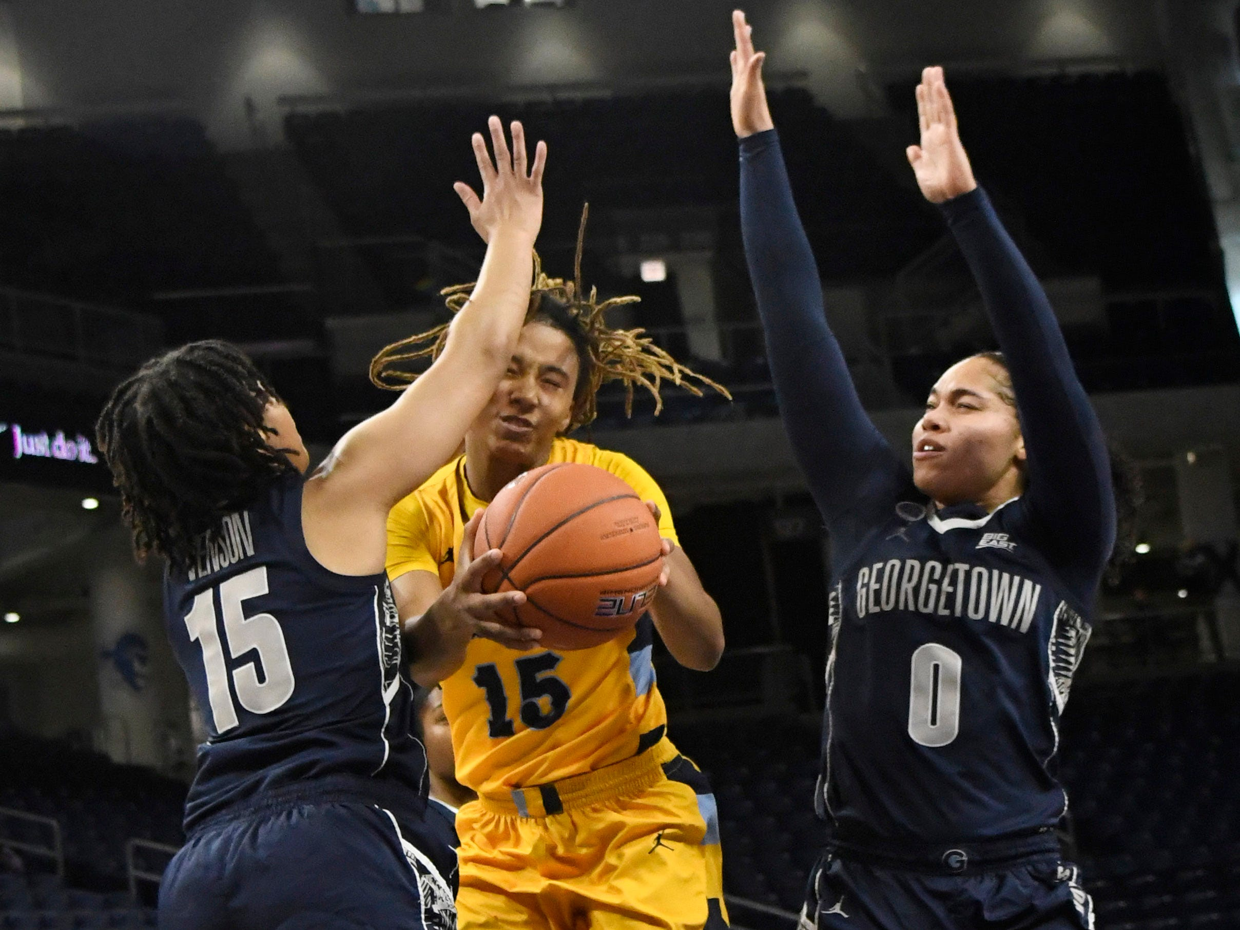 Marquette  guard Amani Wilborn is defended by Georgetown Hoyas guard Mikayla Venson.