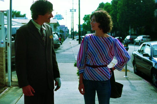 "John Hawkes (left) and Miranda July share a tentative moment in ""Me and You and Everyone We Know,"" written and directed by July."