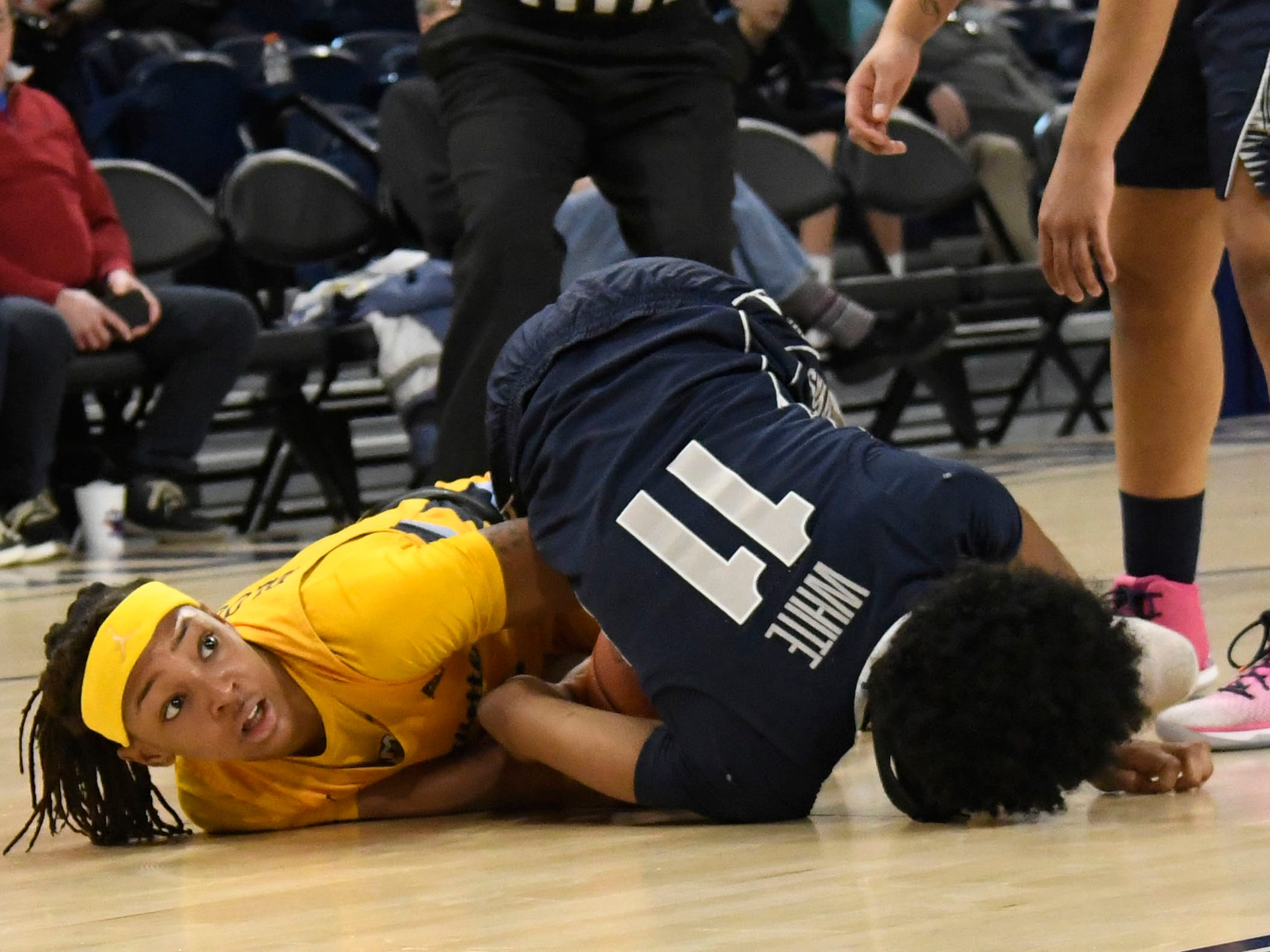 Marquette guard Allazia Blockton and Georgetown guard Dionna White  go for a loose ball during the second half in the women's Big East Conference tournament in Chicago.