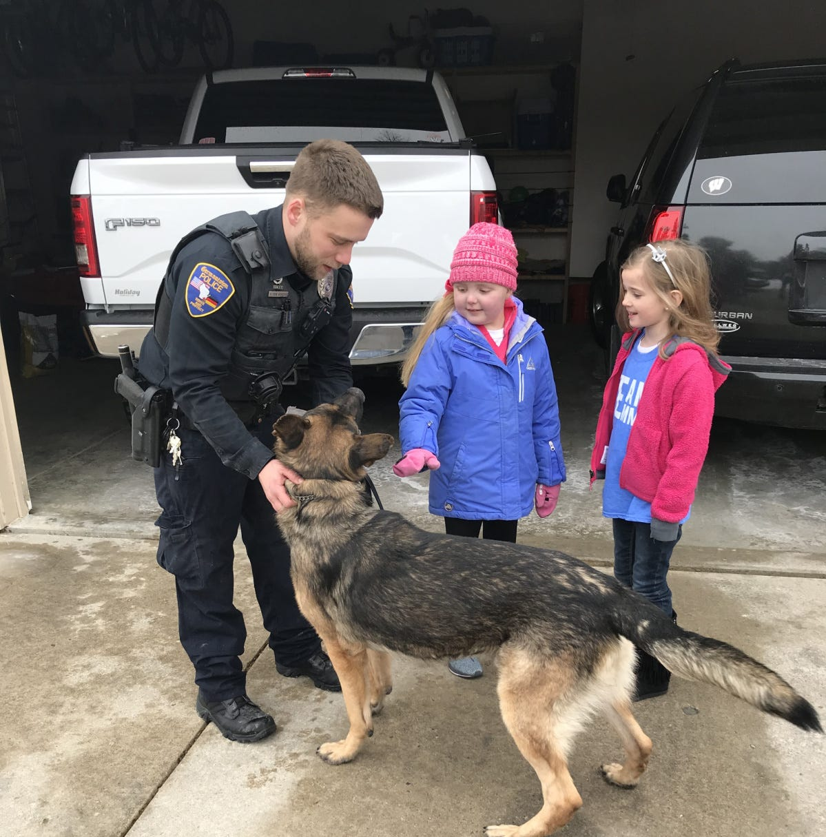 A Hartland 7-year-old with a terminal brain tumor got a visit from nearly 40 police dogs