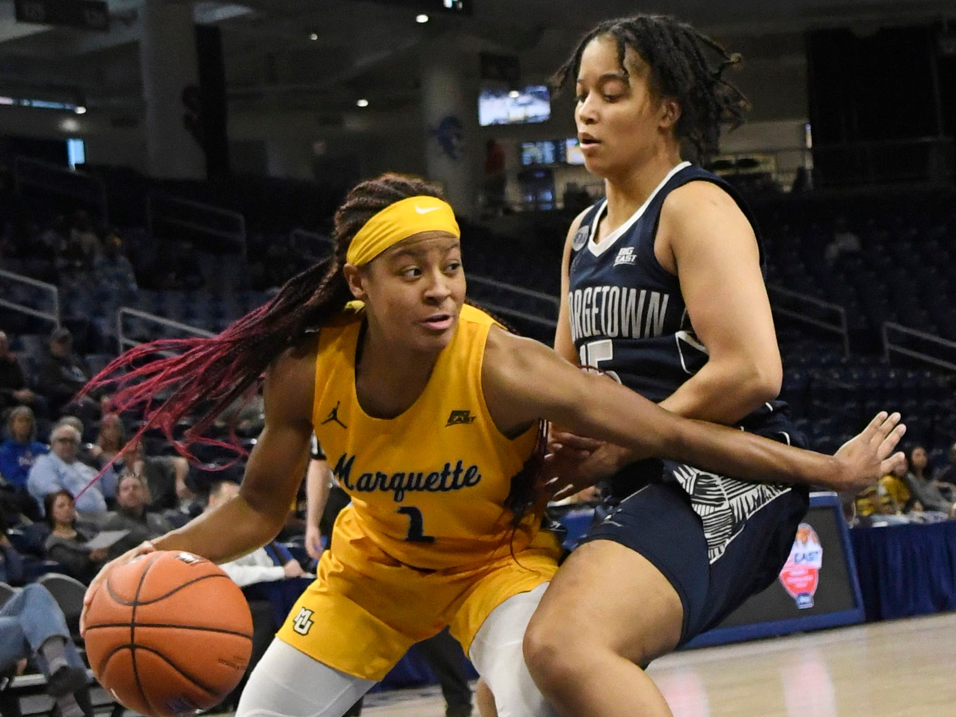 Marquette guard Danielle King drives to the basket and tries to get past Georgetown's Mikayla Venson.
