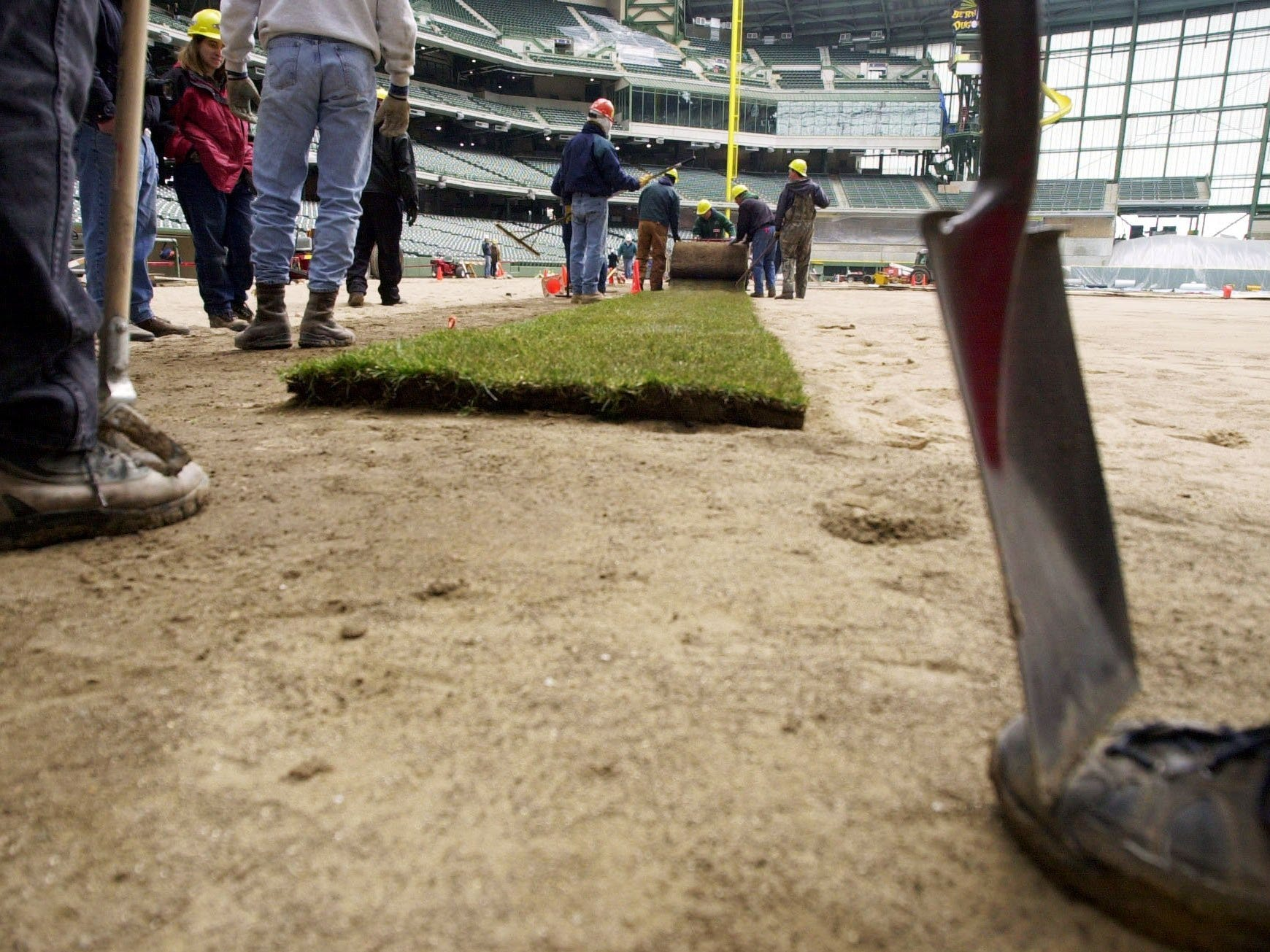 Workers lay the first roll of sod in left field of Miller Park on March 10, 2001, in Milwaukee. Miller Park, the new home of the Milwaukee Brewers, is scheduled to open on April 6 with a game between the Brewers and the Cincinnati Reds. (AP Photo/Milwaukee Journal Sentinel, Jeffrey Phelps)