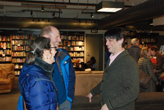 Margret Petrie and Nick Petrie talk with Boswell Books owner Daniel Goldin following a March 11 appearance by novelist Elinor Lipman at the Milwaukee bookstore.