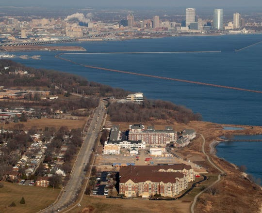 Over 20 acres along the St. Francis lakefront, between the FBI offices and Park Shore condominiums, has been sold to investors.