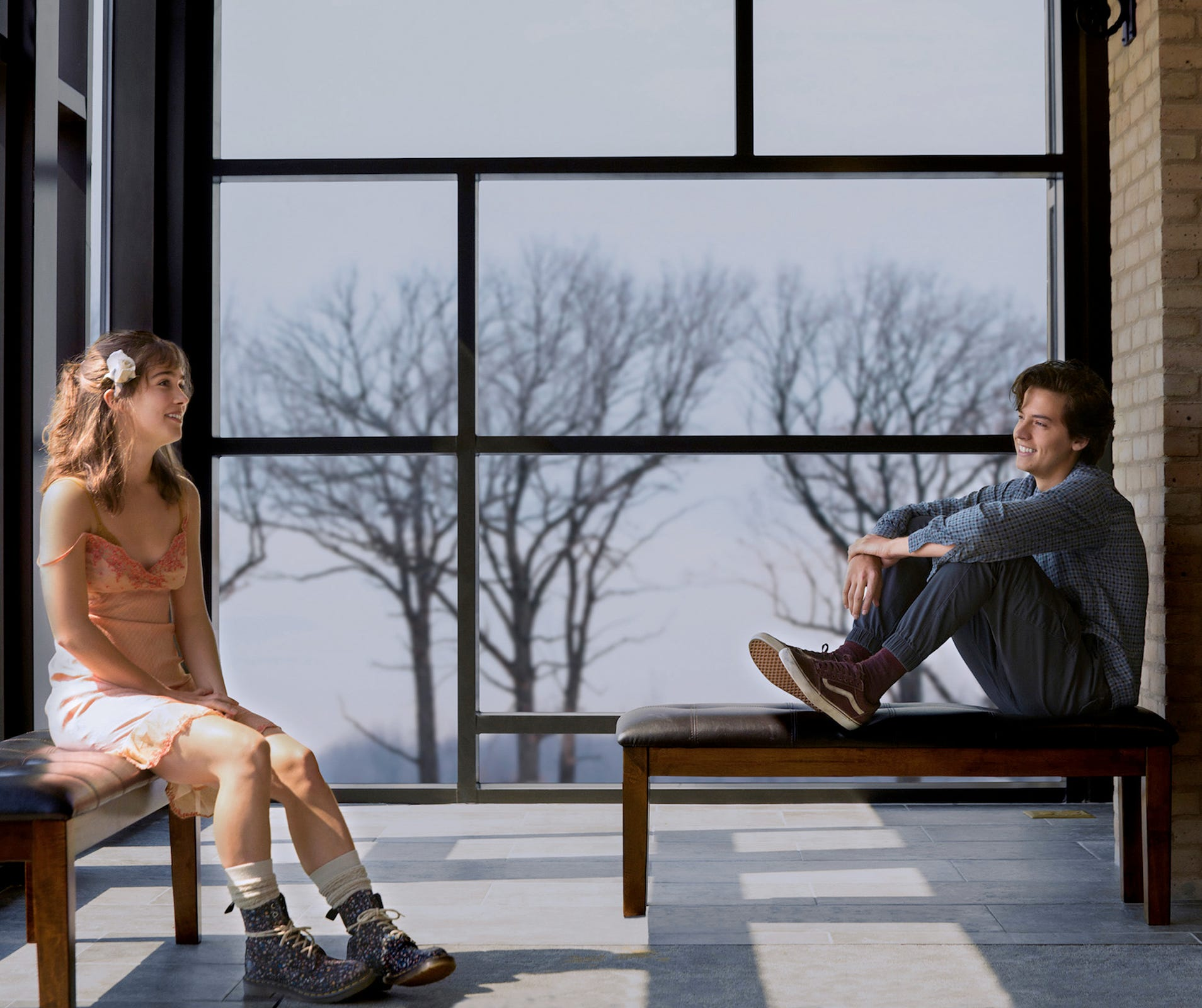 "Haley Lu Richardson (left) and Cole Sprouse try to connect despite the obstacles (including medical) in ""Five Feet Apart."""
