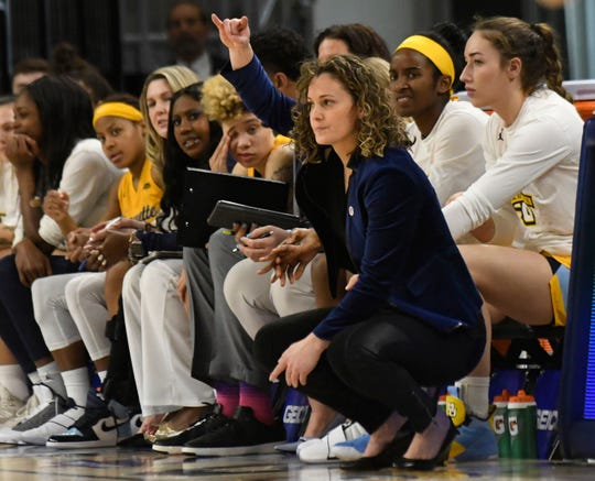 Marquette head coach Carolyn Kieger calls a play from the bench.