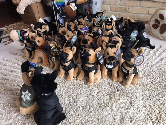 Police officers who brought their dogs to visit Emma Mertens brought along toys and other memorabilia.