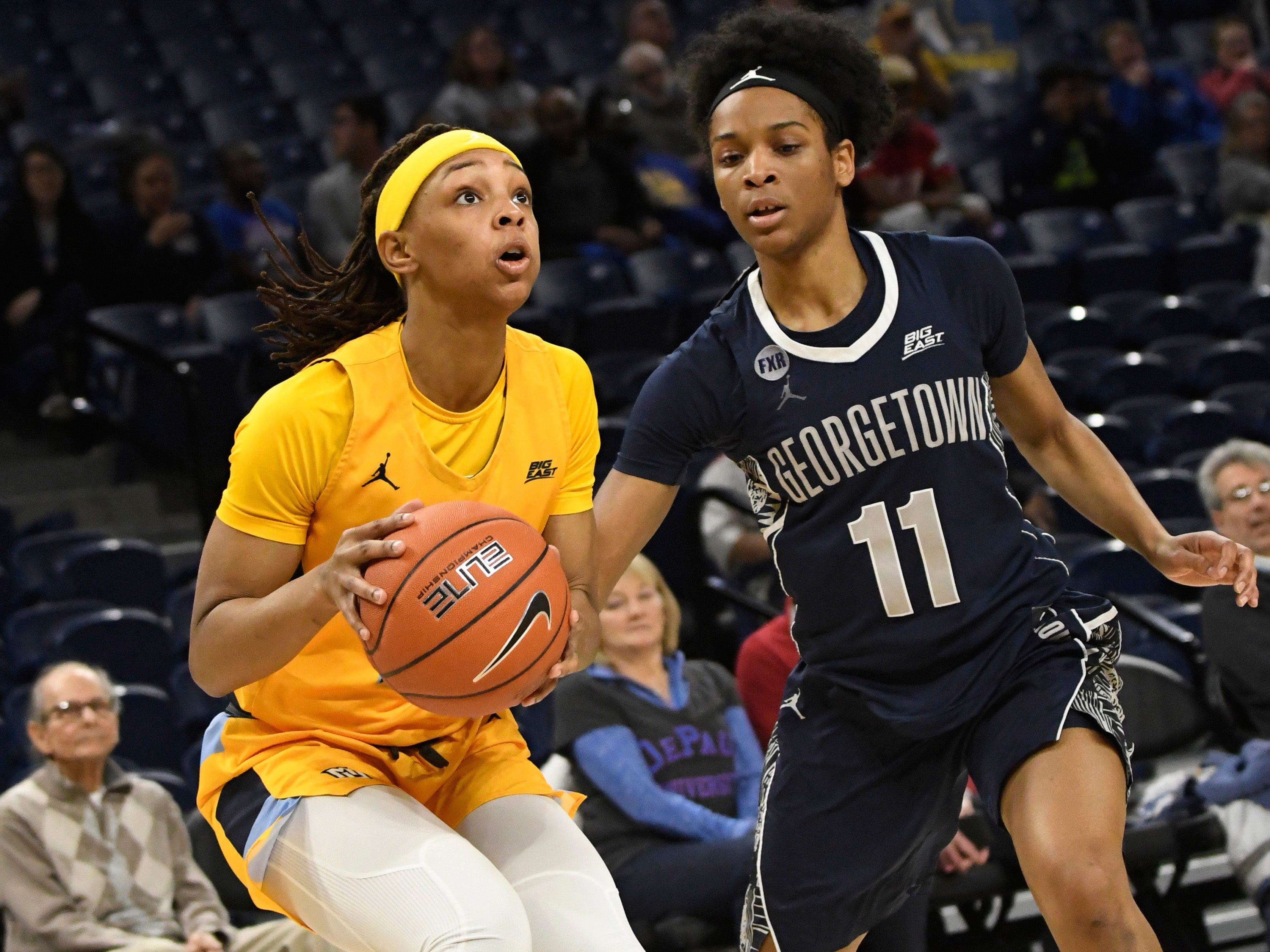 Marquette guard Allazia Blockton (11) is defended by Georgetown guard Dionna White during the first half.