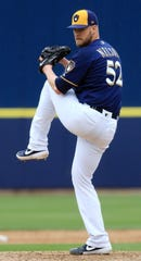 Jimmy Nelson delivers a pitch in the sixth inning.