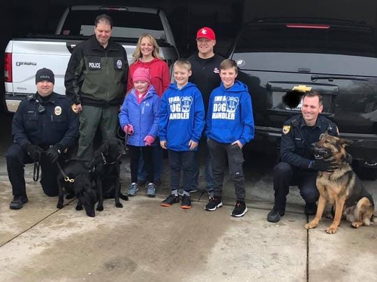 Emma Mertens and her family were surprised by a visit from police dogs from across the state