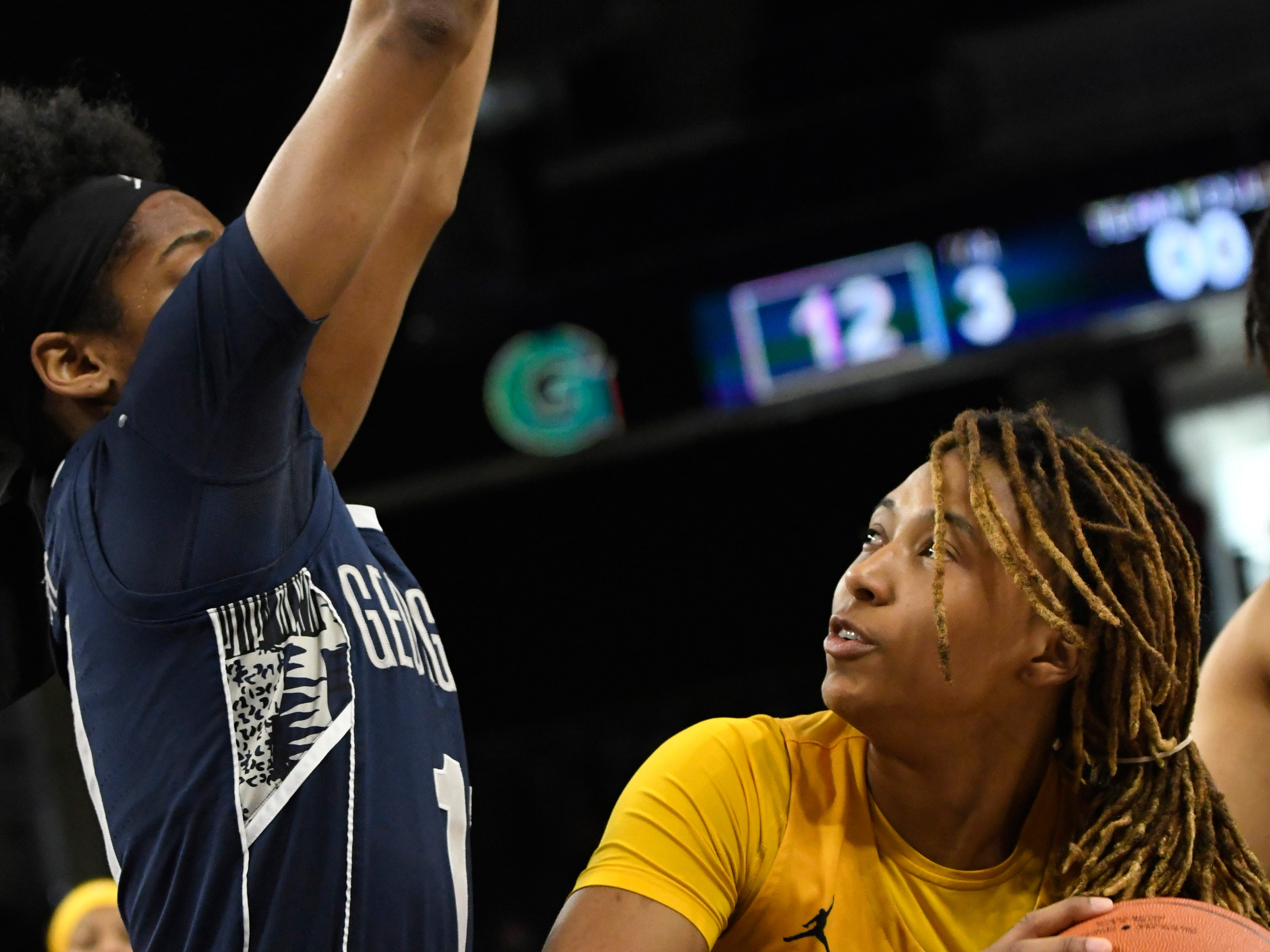 Marquette's Amani Wilborn is defended by Georgetown guard Dionna White.