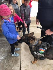 Emma Mertens received a visit from police dogs from across the state on March 9.