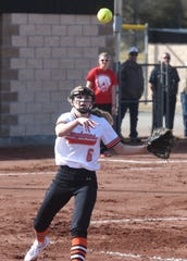 Viola pitcher Keyaira Moore throws to first base for an out against Hillcrest on Monday.