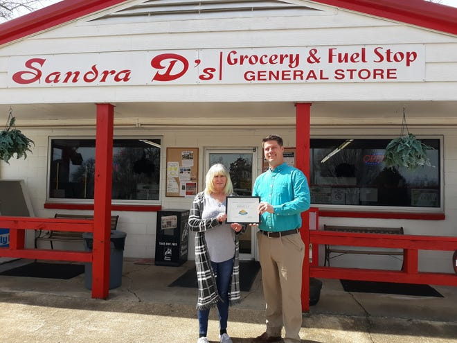 Sandra D's Grocery and Fuel Stop in Gamaliel was recently inducted to the Mountain Home Area Chamber of Commerce. Membership inductions are held for businesses that have been in the Twin Lakes Area for some time, yet recently joined the Chamber. Sandra D's is locally owned and operated and has provided the only fuel (non-ethanol) on Arkansas Highway 101 for many years. The store specializes in fresh sandwiches, homemade potato salad and macaroni salad – a local favorite. They have a full line of groceries, bait and tackle. For more information go to the Chamber's business directory at enjoymountainhome.com.