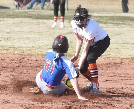 Hillcrest's Abby Orrick (21) slides past the tag of Viola shortstop Sami McCandlis on Monday.