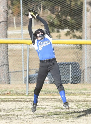 Cotter left fielder Candace Lambert makes a leaping catch against Hillcrest on Monday at Viola City Park.