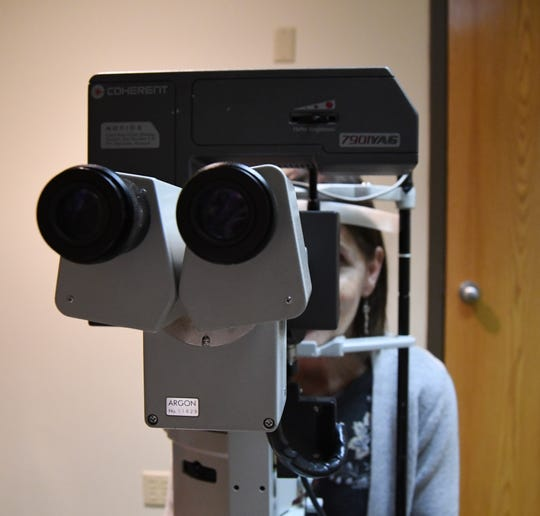 A patient looks into a YAG laser device, which is used to treat certain glaucoma and to remove scar tissue behind the lends following cataract surgery, Tuesday afternoon at the Ozark Eye Center in Mountain Home. House Bill 1251, currently under consideration in the state Senate, would allow optometrists to perform certain types of laser surgery on patients' eyes.