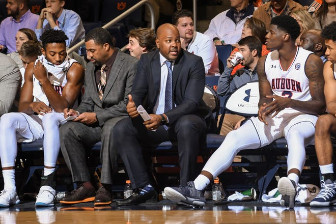 Auburn men's basketball assistant Ira Bowman (center) on the bench during an exhibition against Lincoln Memorial University on Friday, November 2, 2018, in Auburn, Ala.
