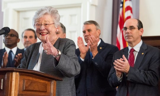 Alabama Governor Kay Ivey gives a thumbs up before she signs the gas tax bill in the state capitol building in Montgomery, Ala., on Tuesday March 12, 2019.