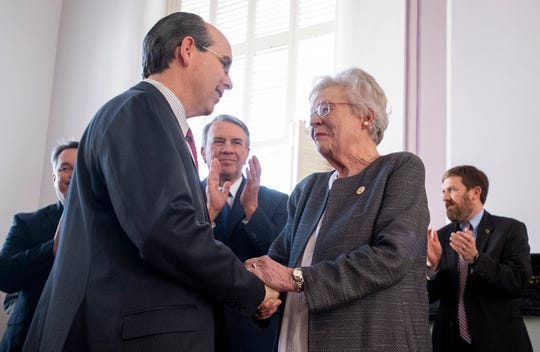 Alabama Governor Kay Ivey thanks Sen. Clyde Chambliss before she signs the gas tax bill in the state capitol building in Montgomery, Ala., on Tuesday March 12, 2019.