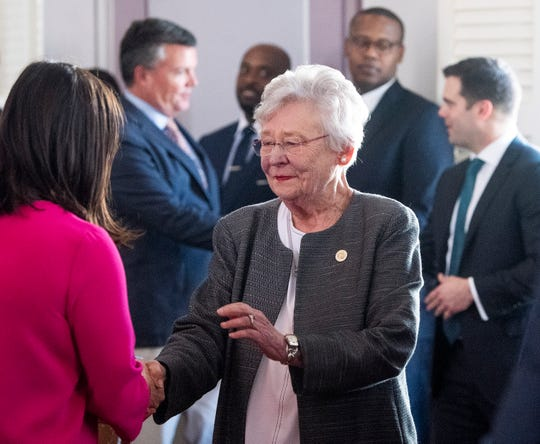 Alabama Governor Kay Ivey greets people before she signs the gas tax bill in the state capitol building in Montgomery, Ala., on Tuesday March 12, 2019.