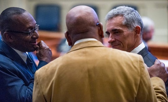 Sen. Bobby Singleton, from left, Se. Rodger Smitherman and Sen. Del Marsh chat during debate on the gas tax bill on the state floor in the Alabama Statehouse in Montgomery, Ala., on Tuesday March 12, 2019.