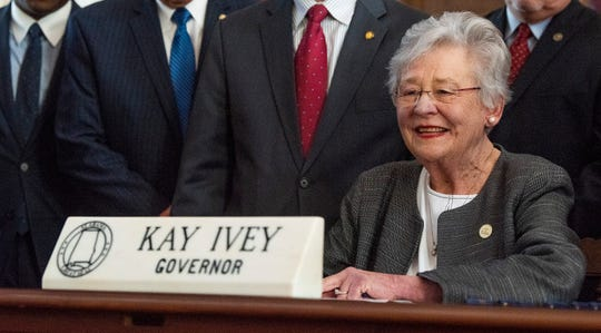 Alabama Governor Kay Ivey signs the gas tax bill in the state capitol building in Montgomery, Ala., on Tuesday March 12, 2019.