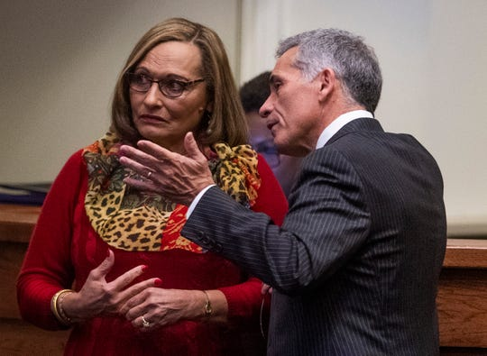 Sen. Vivian Figures and Sen. Del Marsh chat during debate on the gas tax bill on the state floor in the Alabama Statehouse in Montgomery, Ala., on Tuesday March 12, 2019.